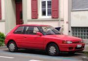1280px-Mazda_323_(41159168285).jpg