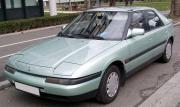 1280px-Mazda_323f_green_front_20080301.jpg